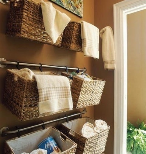 Use Baskets And Rails To Store Bathroom Accessories