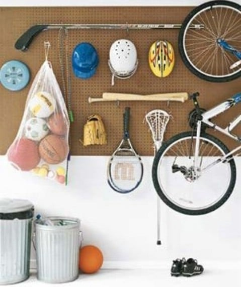 Use a Pegboard with Hooks to Organize Sport Gears - Top 58 Most Creative Home-Organizing Ideas and DIY Projects