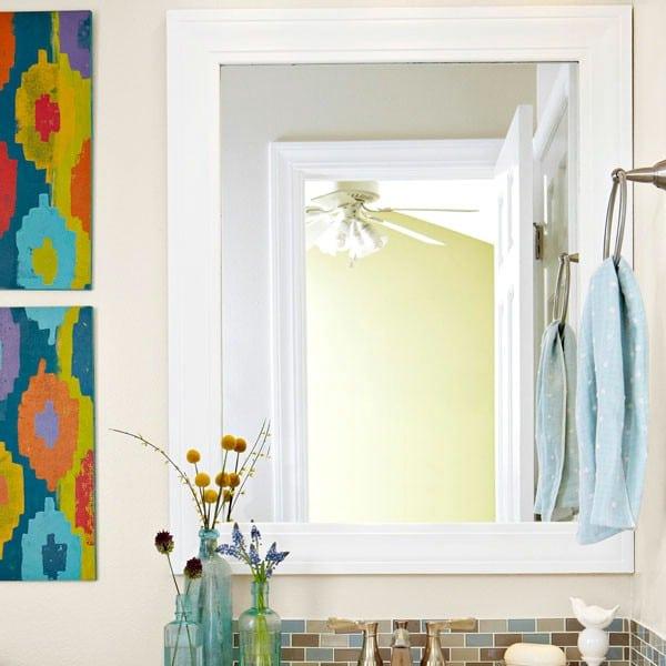Beautiful DIY Mirror Frame - 30 Brilliant Bathroom Organization and Storage DIY Solutions