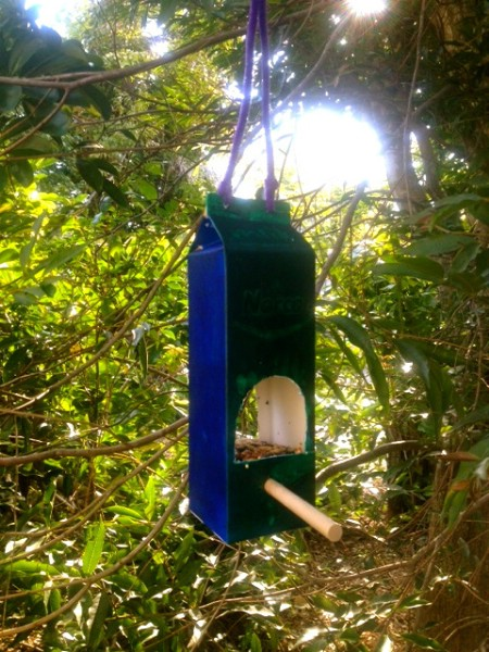 Milk Carton Feeder - 23 DIY Birdfeeders That Will Fill Your Garden With Birds