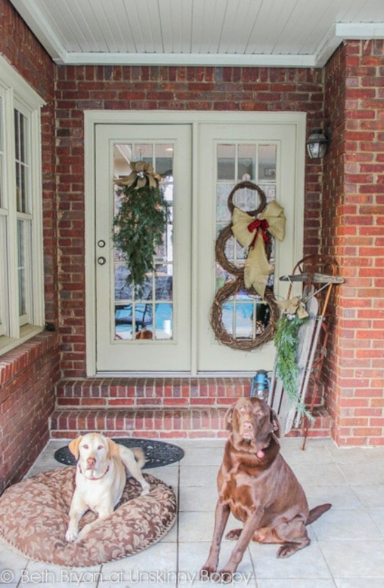 Use Sleds - 60 Beautifully Festive Ways to Decorate Your Porch for Christmas