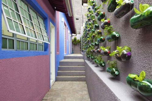 Vertical Soda Bottle Garden - 40 Genius Space-Savvy Small Garden Ideas and Solutions