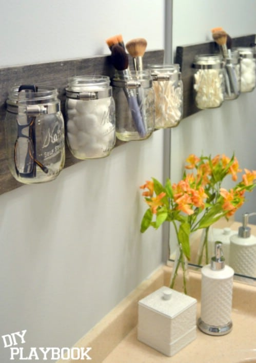 Mason jar organizer - 50 Decorative Rustic Storage Projects For a Beautifully Organized Home