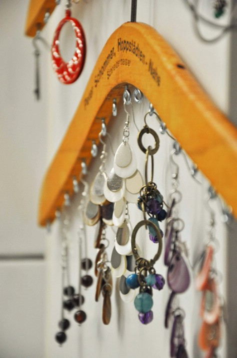 Use an old wooden hangar to store your necklaces.