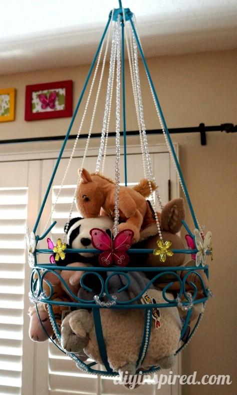 Repurpose a plant hanger for children's toys.