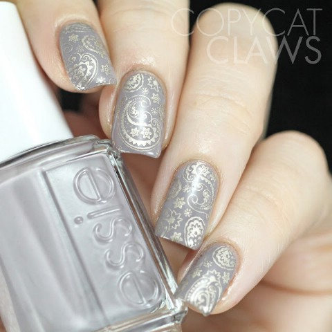 Grey and taupe metallic paisley patterning