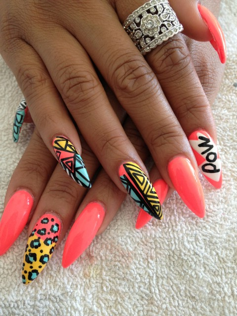 "Boldly patterned ""POW!"" nails"