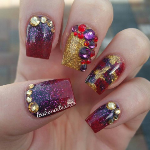 Gold, purple, and red sparkly nails