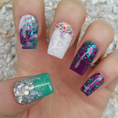 Purple, green, and white eclectic nails