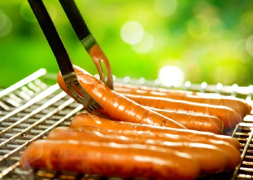 7. Poach your sausages before you grill them.