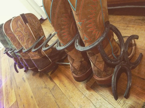 Beautiful boot rack made of horseshoes.