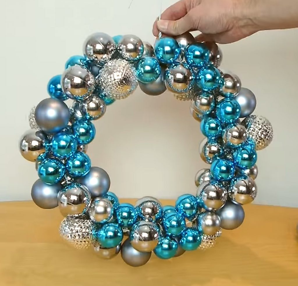 How to Make a Festive Christmas Wreath Out of an Old hanger and Cheap Ornaments {Video}