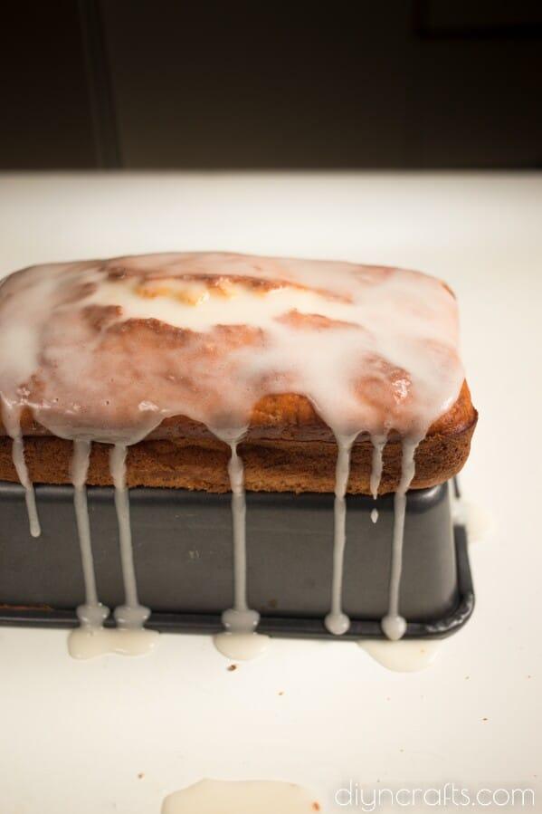 Spooning glaze over bread