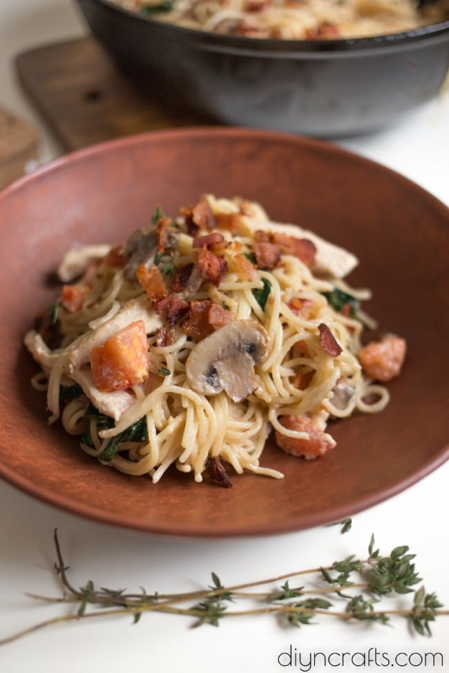 One serving of chicken, bacon, and spinach spaghetti.