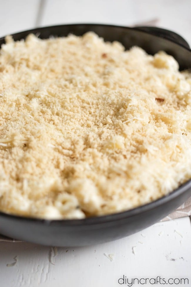 Topping with breadcrumb layer before baking.