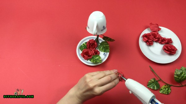 Gluing the roses to fork.