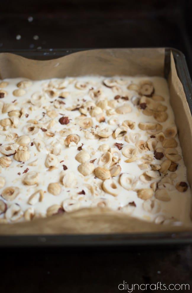 Adding chopped hazelnuts.