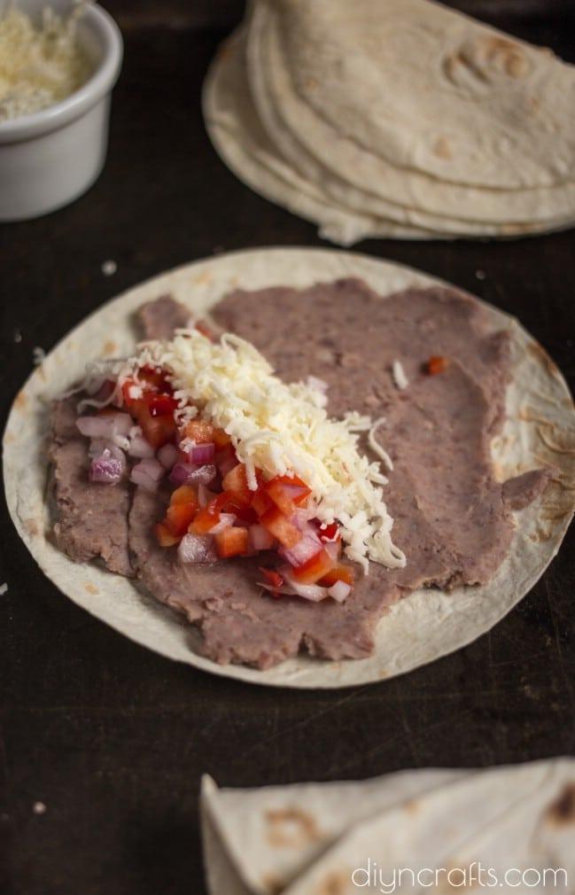 Layering tortillas.