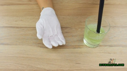 Put on the rubber glove
