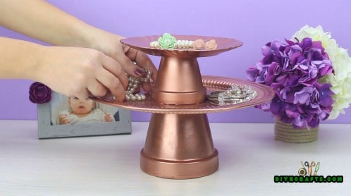 You now have a jewelry stand with two tiers.