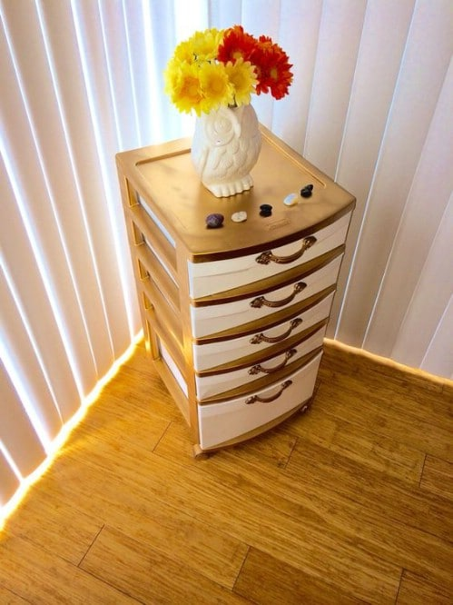 Disguise your plastic bins as a real set of drawers.