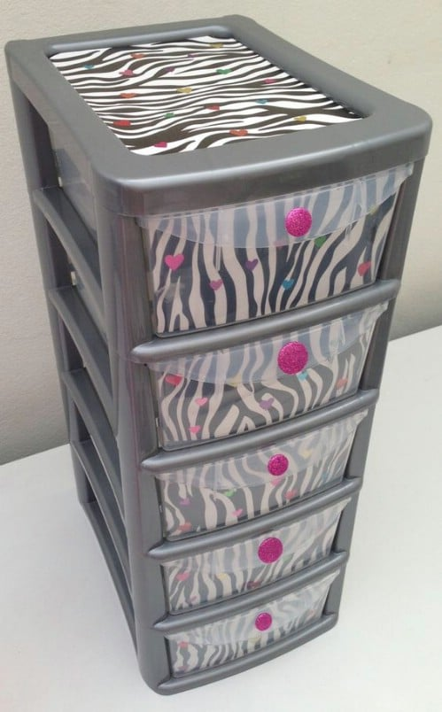 This stylish bin makeover makes great use of color and contrast.