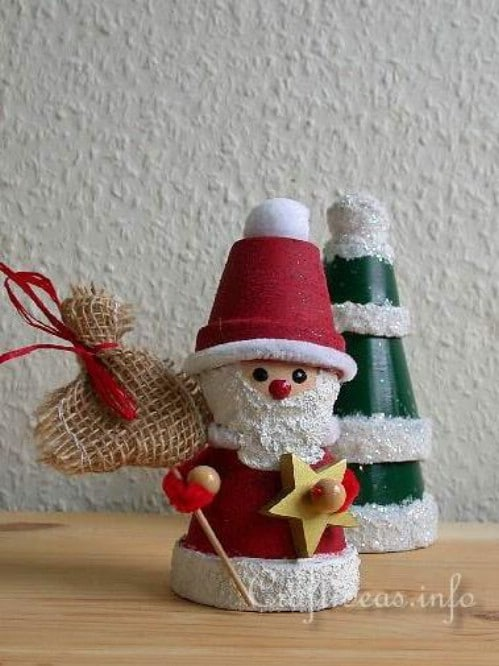 20 diy clay pot christmas decorations that add charm to your holiday whimsical diy clay pot santa claus solutioingenieria Choice Image