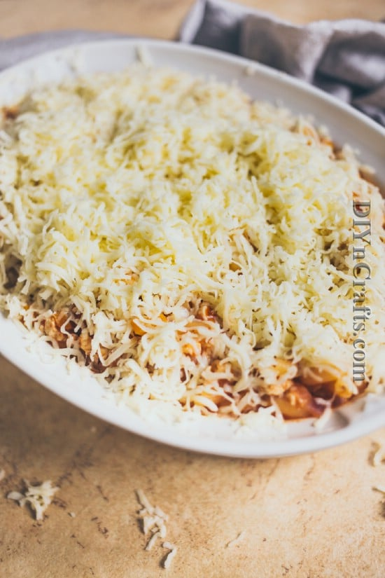 Add all ingredients to casserole dish and cover with shredded cheese
