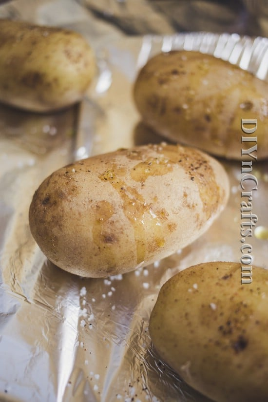 Prick potatoes with a fork and drizzle with olive oil before cooking