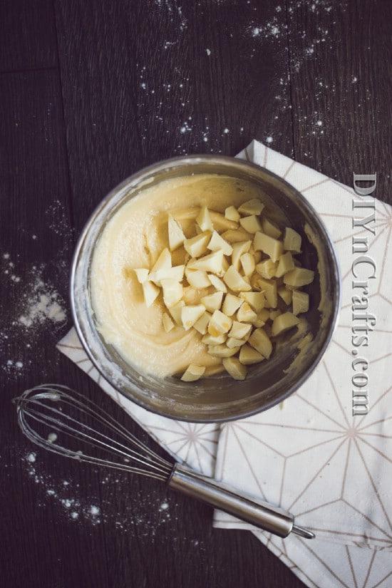 Add white chocolate chunks to blondies before baking