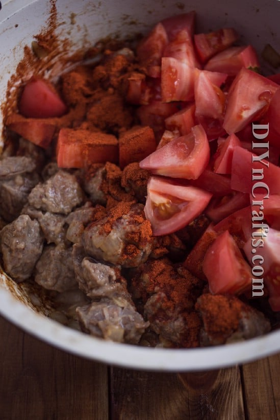 Brown beef and then add in vegetables and spices