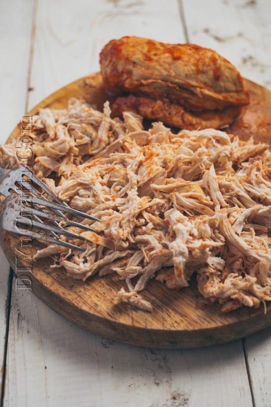 Shredding the chicken breasts.