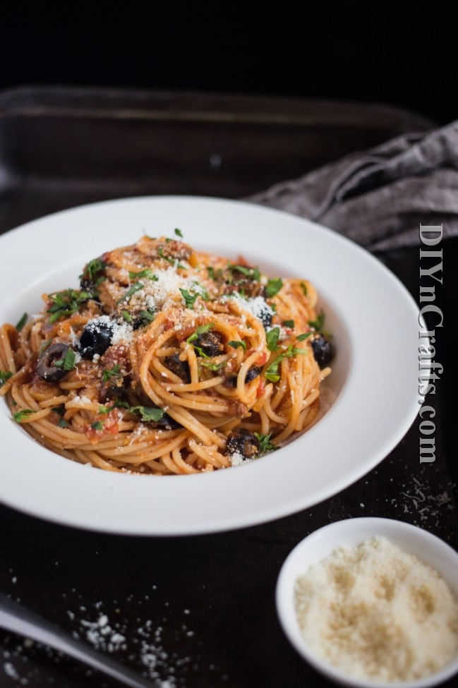 Served finished spaghetti puttanesca.