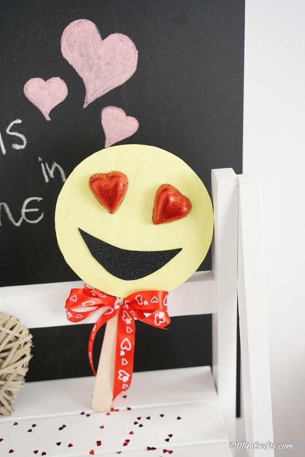 Heart emoji against chalkboard
